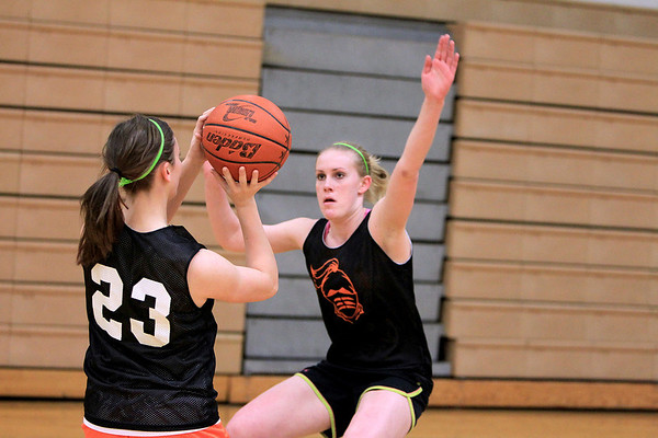 Sandy Bressner - sbressner@shawmedia.com<br /> Kaneland's Kelly Evers tries to block a shot by teammate Lauren Zick during practice Wednesday afternoon.