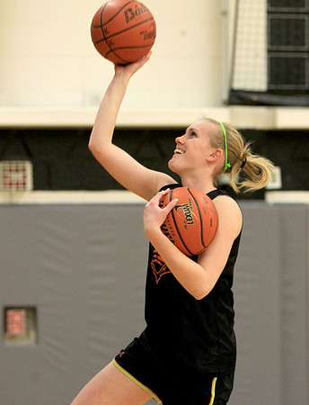 Sandy Bressner - sbressner@shawmedia.com<br /> Kaneland's Kelly Evers works on a lay-up drill during practice Wednesday afternoon.