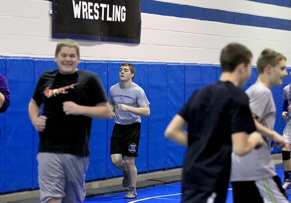 Sandy Bressner - sbressner@shawmedia.com<br /> Geneva High School junior Mark Henriksen jogs with his team during wrestling practice Wednesday at the school.