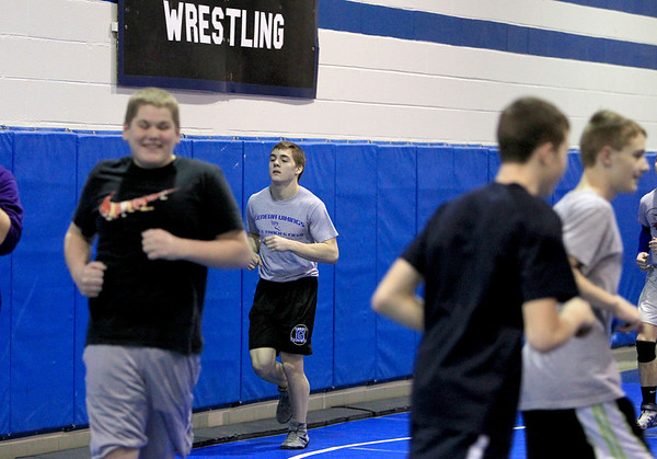 Sandy Bressner - sbressner@shawmedia.com<br /> Geneva High School junior Mark Henriksen jogs with his team during wrestling practice Wednesday at the school.