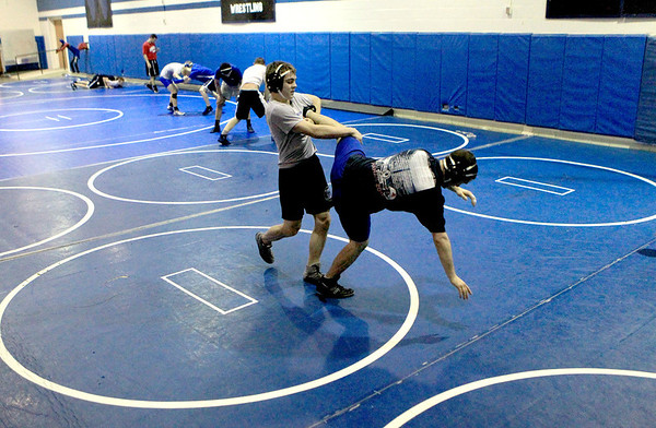 Sandy Bressner - sbressner@shawmedia.com<br /> Geneva High School junior Mark Henriksen (left) wrestles teammate Alex Kunkel during practice Wednesday at the school.