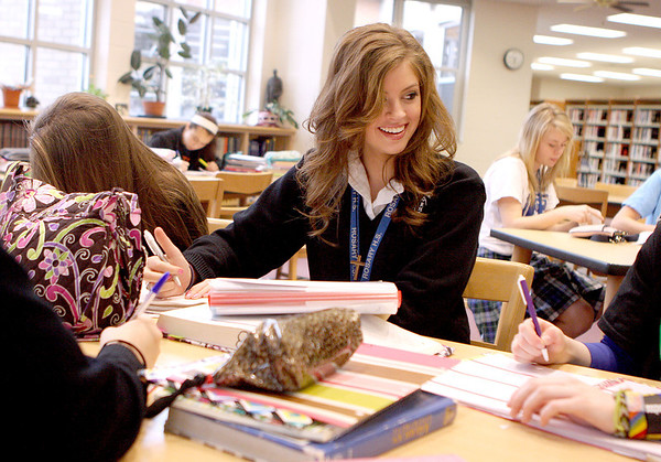 Sandy Bressner - sbressner@shawmedia.com<br /> Rosary High School senior Alex Plotz, 17, of Geneva talks with her friends during study hall in the library at the school Thursday. Plotz was crowned Miss Illinois Teen USA last November.