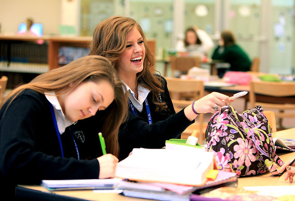 Sandy Bressner - sbressner@shawmedia.com<br /> Rosary High School senior Alex Plotz, 17, of Geneva laughs with her friends including Victoria Ingraham during study hall in the library at the school Thursday. Plotz was crowned Miss Illinois Teen USA last November.