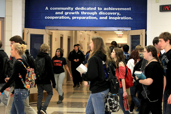 Sandy Bressner - sbressner@shawmedia.com<br /> Students pass through the main hallway of St. Charles North High School during a passing period Thursday. Many teachers at the high school have their National Board Certification, which enables them to receive the same amount of compensation as those with PhDs.
