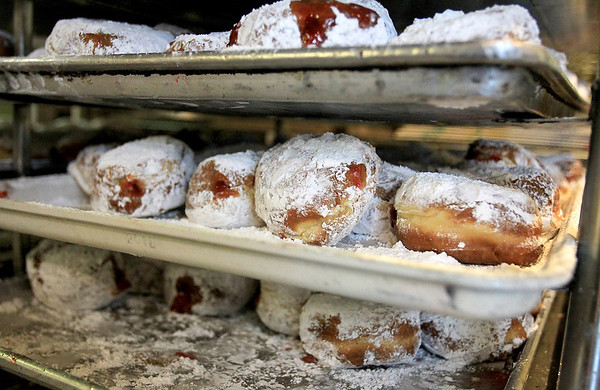 Sandy Bressner - sbressner@shawmedia.com<br /> Traditional Polish paczki wait to be boxed in the kitchen of Harner's Bakery in North Aurora Tuesday morning in honor of Fat Tuesday. Bakers worked around the clock starting Monday to create the fruit and sugar-filled pastries.