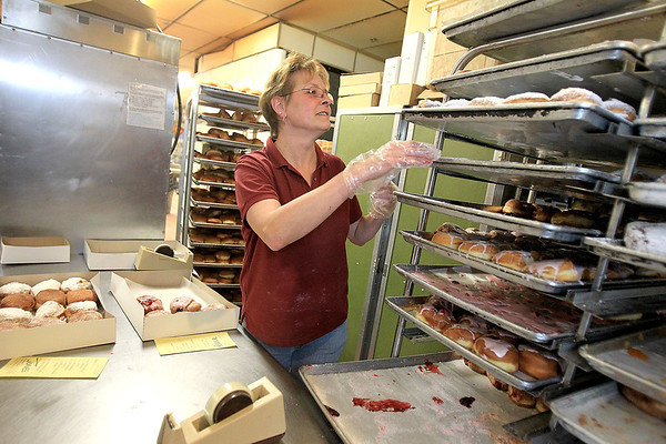 Sandy Bressner - sbressner@shawmedia.com<br /> Laurie Wardingley boxtes traditional Polish paczki in the kitchen of Harner's Bakery in North Aurora Tuesday morning in honor of Fat Tuesday. Bakers worked around the clock starting Monday to create the fruit and sugar-filled pastries.