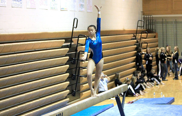 Sandy Bressner - sbressner@shawmedia.com<br /> Claire Scatterday of Geneva competes on the balance beam during the 2012 IHSA Regional Gymnastics Championships at Geneva High School Thursday.