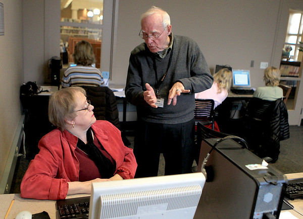 Sandy Bressner - sbressner@shawmedia.com<br /> Instructor Bob Brubaker helps Jane Carlson of Batavia during a Microsoft Word computer class at the Batavia Public Library. Carlson is semi-retired and is hoping to learn the software for a future job.