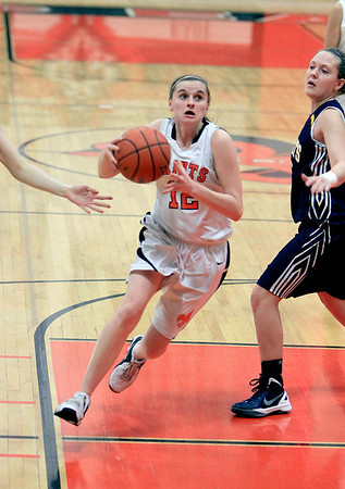 Sandy Bressner - sbressner@shawmedia.com<br /> Paige Jordan of St. Charles East goes in for a layup during their game against Neuqua Valley at East Thursday.