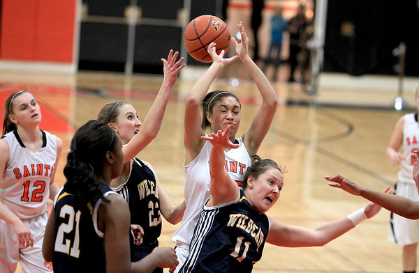 Sandy Bressner - sbressner@shawmedia.com<br /> St. Charles East's Jordan Shead (center) juggles a rebound with Neuqua Valley players during their game at East Thursday.