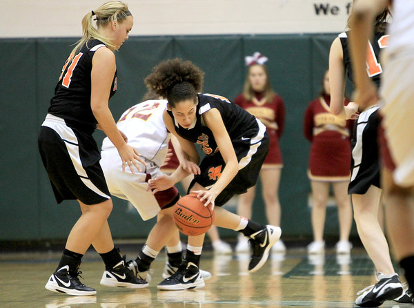 Sandy Bressner - sbressner@shawmedia.com<br /> Kyra Washington of St. Charles East tries to grab a loose ball during their IHSA Class 4A regional game against Schaumburg Tuesday at Bartlett High School.
