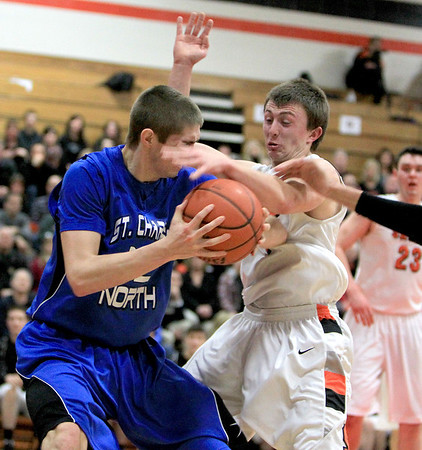 Sandy Bressner - sbressner@shawmedia.com<br /> St. Charles East's Charlie Fisher tries to steal the ball from St. Charles North's Quinten Payne during their game at East Wednesday night.