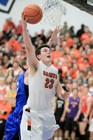 Sandy Bressner - sbressner@shawmedia.com<br /> St. Charles East's Johnny Hondlik gets a shot in during their 63-50 regional game win over St. Charles North Wednesday.
