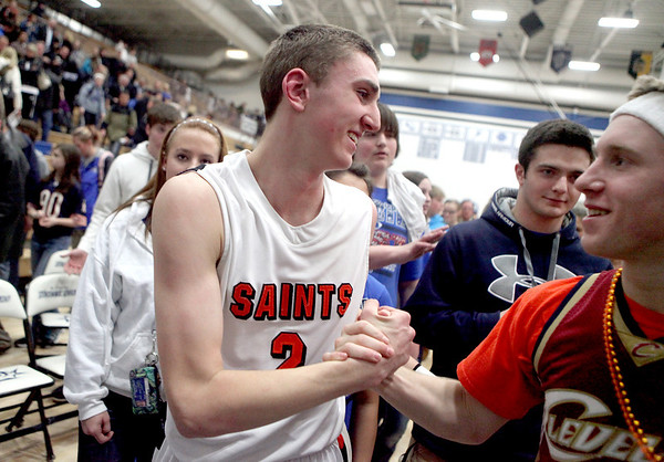 Sandy Bressner - sbressner@shawmedia.com<br /> St. Charles East's Dominic Adduci is congratulated following their 63-50 regional game win over St. Charles North Wednesday.