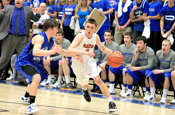 Sandy Bressner - sbressner@shawmedia.com<br /> St. Charles East's Dominic Adduci drives toward the basket during their 63-50 regional game win over St. Charles North Wednesday.