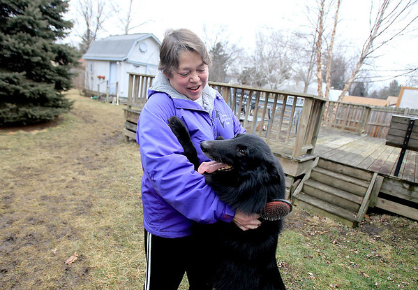 Sandy Bressner - sbressner@shawmedia.com<br /> Susan Manier and her 3-year-old Belgian sheepdog, Hondo, play outside her Batavia home. Hondo, whose full name is Bonntymes Keepin it Real at Divine, won Best in Breed at the Westminster Kennel Club Dog Show last week.