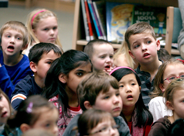 "Sandy Bressner - sbressner@shawmedia.com<br /> Students at Heartland Elementary School in Geneva listen as children's book author and illustrator Tom Lichtenheld gives a presentation about how books are made Monday afternoon. Lichtenheld is a New York Times best-selling and award winning author. His books include, ""Goodnight, Goodnight Construction Site,"" ""Shark vs. Train"" and Bridget's Beret."""