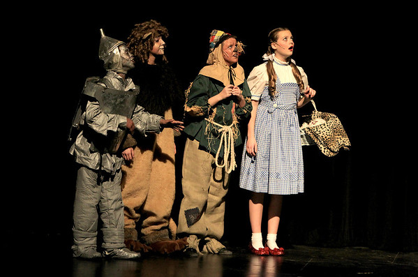 Sandy Bressner - sbressner@shawmedia.com<br /> (Right to left) Lauren Nicole of St. Charles as Dorothy, Mary Mueller of Batavia as the Scarecrow, Nicoletta Calabrese of St. Charles as th Lion and Manny Groth of St. Charles as the Tin Man rehearse a scene for a production of The Wizard of Oz at the Batavia Fine Arts Centre. Performances run Feb. 10-12.