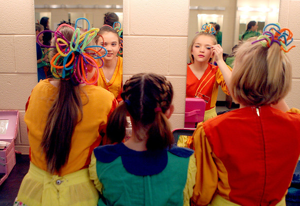 Sandy Bressner - sbressner@shawmedia.com<br /> Cast members (from left) Addison Zima, 10, of Geneva, Alyssa Robinson, 10, of St. Charles and Megan Styrna, 11, of Geneva put their makeup on backstage during rehearsals for a production of The Wizard of Oz at the Batavia Fine Arts Centre. Performances run Feb. 10-12.