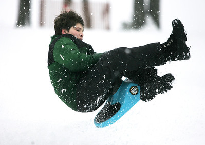 Monica Maschak - mmaschak@shawmedia.com Danny Truckenbrod, 12, flies off a ramp built by him and his frieds at Veteran Acres Park in Crystal Lake on Wednesday, February 27, 2013. Kids and families took advantage of more than six inches of snow dumped on the area Tuesday with more snow expected in the forecast.