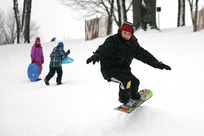Monica Maschak - mmaschak@shawmedia.com Joey Fitzgerald, 9, gets some air on a jump built of snow at Veteran Acres Park in Crystal Lake on Wednesday, February 27, 2013. Kids and families took advantage of the snow dumped on the area the night before.