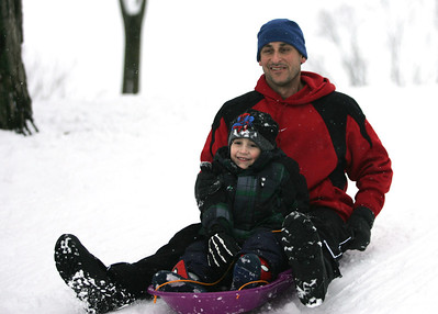 Monica Maschak - mmaschak@shawmedia.com Nathan Caruso, 4, and his dad Tony Caruso push off to sled down the hill at Veteran Acres Park in Crystal Lake on Wednesday, February 27, 2013. Kids and families took advantage of more than six inches of snow dumped on the area the day before.