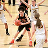 Kyra Washington of St. Charles East looks to pass the ball to a teammate during their game at Metea Valley Thursday night.
