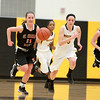 St. Charles East's Carly Pottle steals the ball in the fourth quarter of their win over Metea Valley Thursday night.