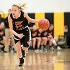 St. Charles East's Katie Claussner drives toward the basket during their game at Metea Valley Thursday night.