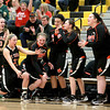The St. Charles East bench celebrates in the fourth quarter of their win over Metea Valley Thursday night.