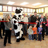 Batavia Mayor Jeff Schielke (center, right) joins franchise owners Jamie (far left) and Murray Collier (center) to cut the ribbon for the new Chick-fil-A in Batavia Thursday morning.