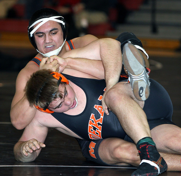 Jeff Krage – For the Northwest Herald McHenry's Luis Hernandez, top, wrestles with DeKalb's Alex Roach in a 220-pound match during Saturday's IHSA class 3A Individual Sectional at Barrington High School. Barrington 2/9/13