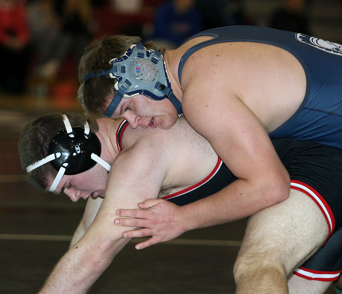 Jeff Krage – For the Northwest Herald Cary-Grove's Nick Huff, top, wrestles with Barrington's Jack Bornofen in a 220-pound match during Saturday's IHSA class 3A Individual Sectional at Barrington High School. Barrington 2/9/13