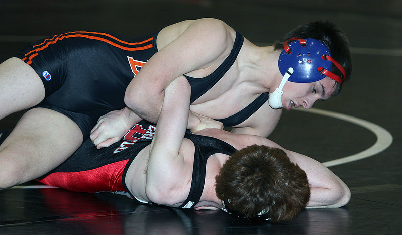 Jeff Krage – For the Daily Chronicle DeKalb's Nick Roach, top, wrestles with Deerfield's Joey Bloom in a 120-pound match during Saturday's IHSA class 3A Individual Sectional at Barrington High School. Barrington 2/9/13