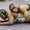 Rob Winner – rwinner@shawmedia.com<br /> <br /> Kaneland's Esai Ponce (top) controls Washington's Randy Meneweather during their 132-pound third place match at the Class 2A Rochelle Sectional on Saturday, Feb. 9, 2013. Ponce won with a 7-0 decision.