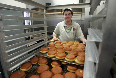 "H. Rick Bamman - hbamman@shawmedia.com While some people celebrate Fat Tuesday with colored masks and partying, many area residents celebrate by treating themselves to paczki (pronounced ""pounch-ski"") traditional Polish pastries with jelly fillings. Country Donuts clears out the dinning area so they can handle the volume of orders. Country Donuts co-owner Scott Offord rolls out the dough. Baker's helper Michael Salerno. Gabby Arias grabs a box for a customer. Customers Joan and Ben Larsen.  (Tina Griffith and Stephanie Parison)"