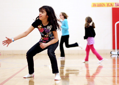 Sarah Nader - snader@shawmedia.com Cassandra Soto, 9, of Crystal Lake runs around while playing capture the flag at an after school program provided by the Crystal Lake Park District at Woods Creek Elementary School in Crystal Lake on Friday, February 15, 2013.