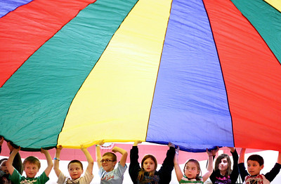 Sarah Nader - snader@shawmedia.com Kids play with a parachute while at an after school program provided by the Crystal Lake Park District at Woods Creek Elementary School in Crystal Lake on Friday, February 15, 2013.