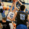 Pace Temple of Geneva grabs a rebound during their home game against St. Charles North Friday night.