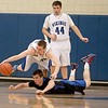 Pace Temple of Geneva scrambles over St. Charles North's Ryan Thomas during their game at Geneva Friday night.