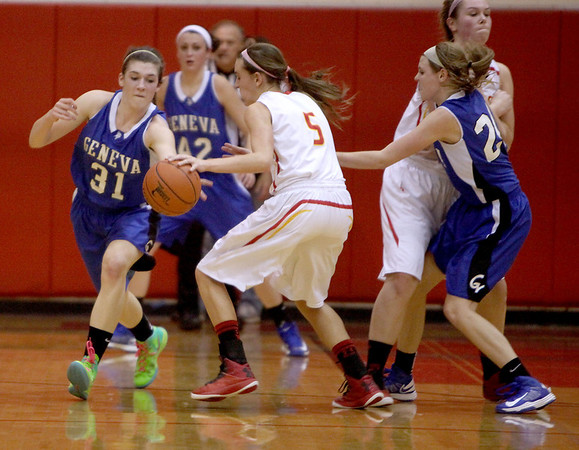 Geneva's Sami Pawlak grabs the ball out of the hands of Batavia's Liza Fruendt during a game last month.