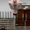 St. Charles East diver practices at the school Tuesday. Schmitt will be competing in the state meet at New Trier High School this weekend.