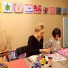 Instructor August Vollbrecht helps Ava Moskal, 5, with a painting during a class at the Art Box in Geneva.