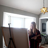 Artist Kerri Branson works on a painting in the studio of her North Aurora home.