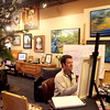 Artist Len Bielefeldt paints at his Art Box shop in Geneva.