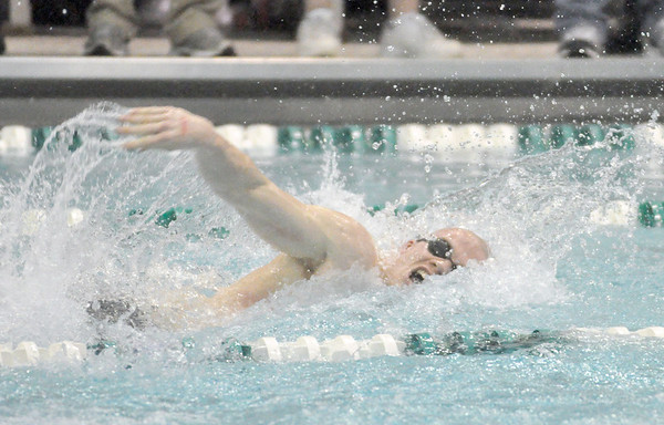 Bill Ackerman — backerman@shawmedia.com<br /> St. Charles East's Taylor Nunnery swims the anchor leg of the 200 yard freestyle relay in the consolation final at the IHSA state boys swimming and diving finals at New Trier East High School on Saturday, Feb. 23, 2013.