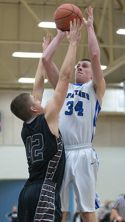 St. Francis' Kevin McShea shoots over Kaneland's Matt Limbrunner at The Class 3A IMSA Regional Semifinals in Aurora, IL on Wednesday, February 27, 2013 (Sean King for The Kane County Chronicle)