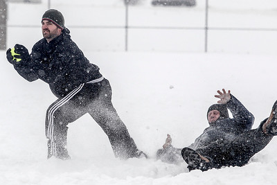 "Sarah Nader- snader@shawmedia.com Mike Carzoli (left) of McHenry catches the ball while Shaun Kaszniak of Crystal Lake slides into first base during the 36th Annual Men's 16"" Snowbird Softball Tournament at Lippold Park in Crystal Lake Saturday, February 1, 2014."