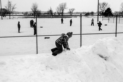 "Sarah Nader- snader@shawmedia.com Mareena Berge, 8, of Crystal Lake play on a huge snow pile at Lippold Park in Crystal Lake during the 36th Annual Men's 16"" Snowbird Softball TournamentSaturday, February 1, 2014."