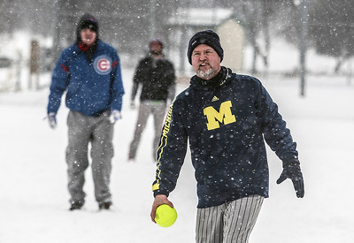 "Sarah Nader- snader@shawmedia.com Kevin Thomas of Round Lake Beach pitches a ball during the 36th Annual Men's 16"" Snowbird Softball Tournament at Lippold Park in Crystal Lake Saturday, February 1, 2014."